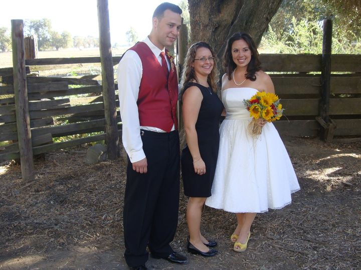 Groom, officiant, and bride