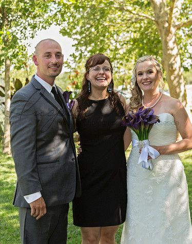 Groom and bride with the officiant