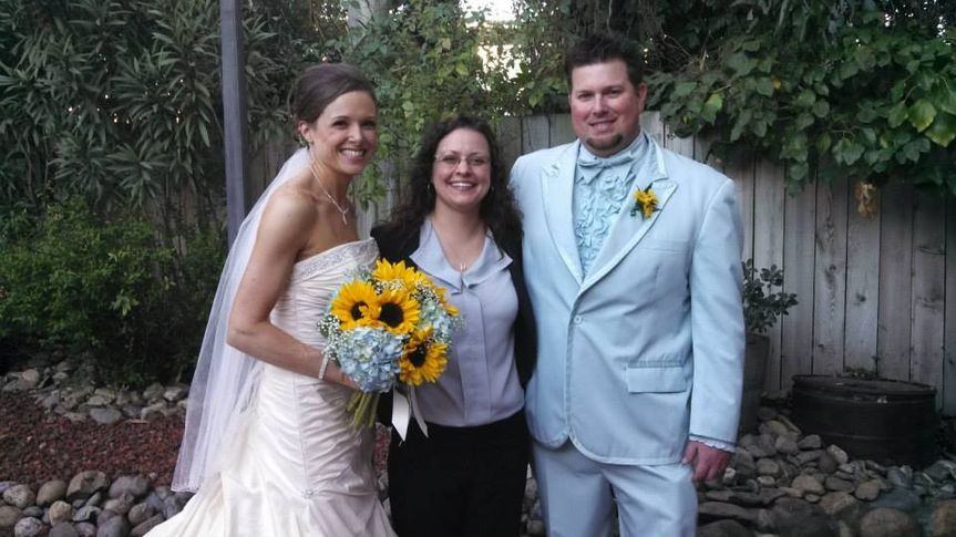 Bride and groom with their officiant