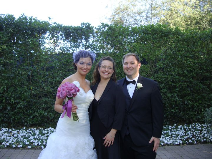 Wedding officiant with the newlyweds