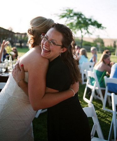 Bride hugging the officiant