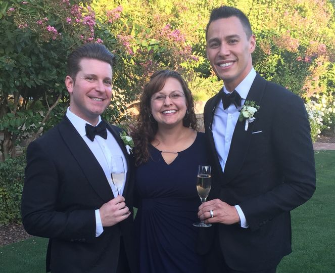Wedding officiant with the grooms
