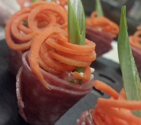 "Our ""Antipasto Cones"" Cured Italian Meats, filled with Boursin cheese and various toppings......"