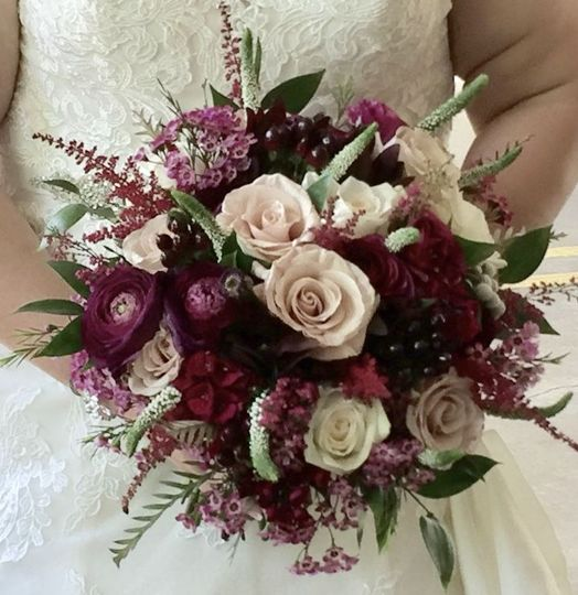 Rich and vibrant plum shades pared with blush roses are a stunning combination .