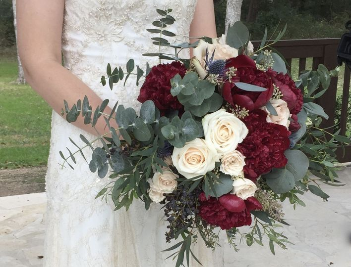 Gorgeous marsala peonies anchor this eucalyptus bouquet.