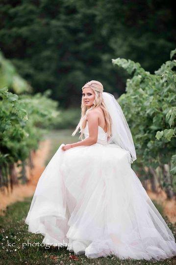 bride in vineyard rows sharp focus kc photograp