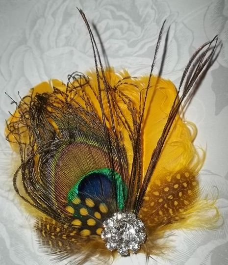 Yellow and peacock feathered bridal fascinator hair clip