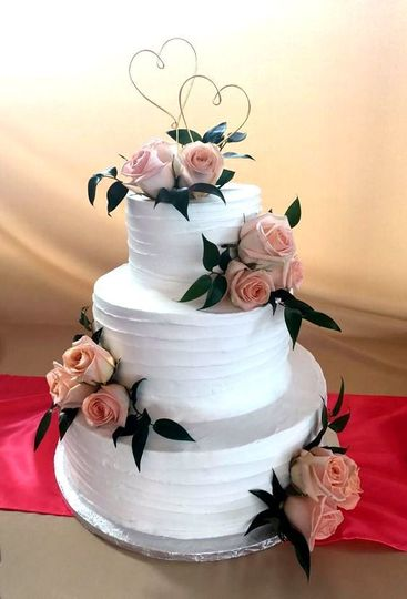 Textured cake with pink flowers