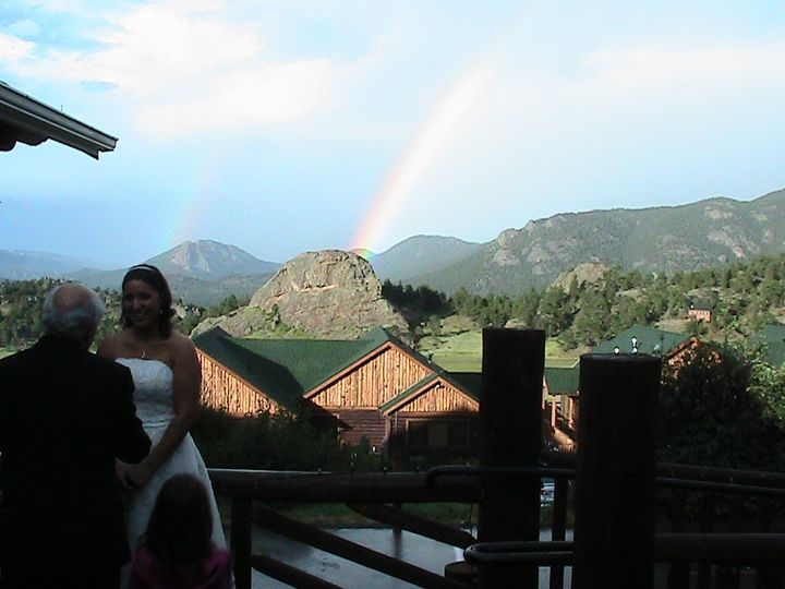 A Sharp Dj Service with a rainbow after the ceremony at Mary's Lake Lodge in Estes park.