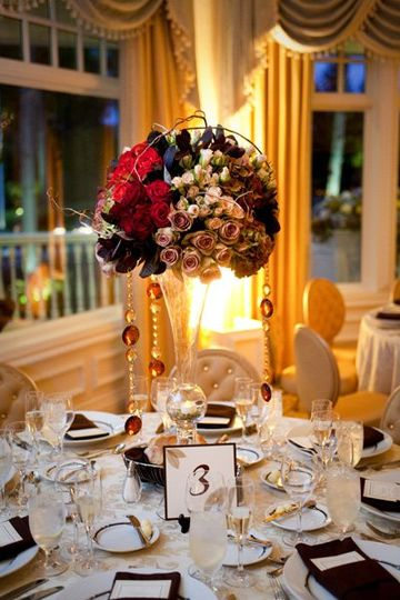 The centerpiece is the hallmark of the table and of my design style. Again, my florist is my...