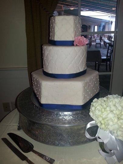 Three tier wedding cake with blue lining