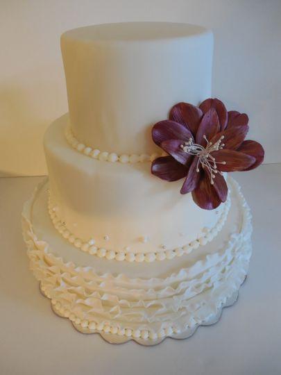 Three tier wedding cake with chocolate flower