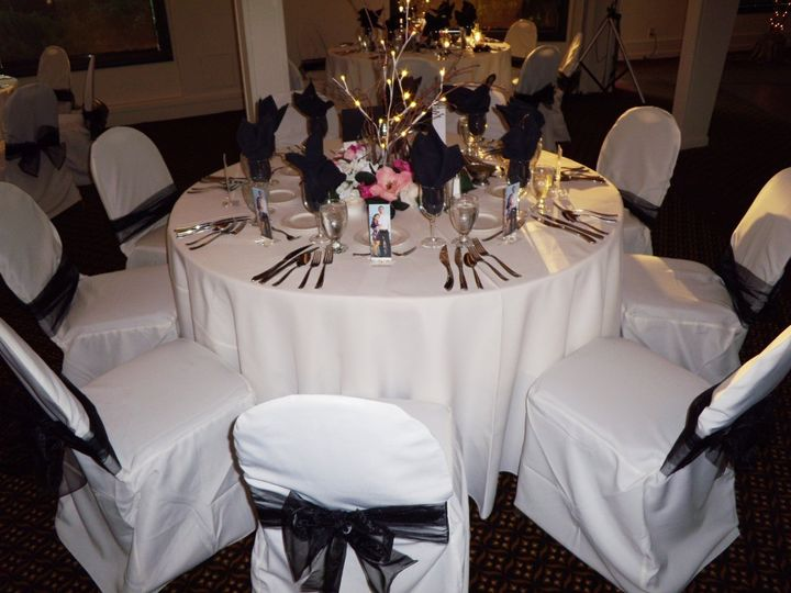 White reception table with black decor