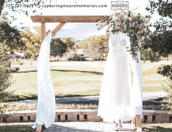 Wedding Dress at Ceremony Arch