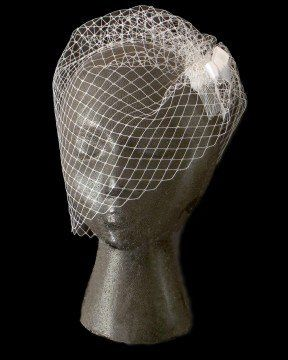 Angled, Side gathered Birdcage Veil with delicate satin ribbon bow on comb.  By...