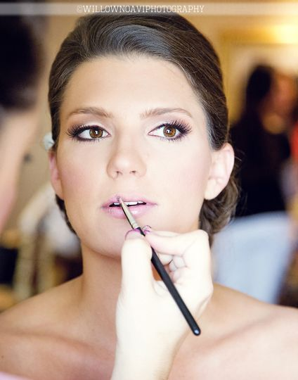 Putting on lipstick