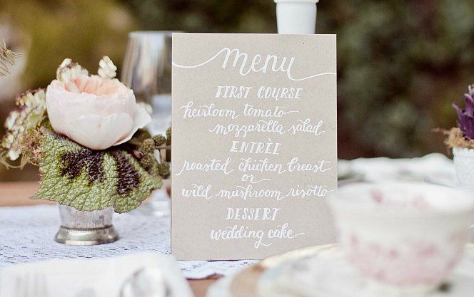 The Megan Suite - A simple hand-lettered menu with white ink on kraft paper  (Photo courtesy of...