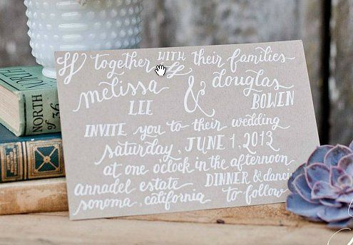 The Megan suite invitation with white ink on kraft paper  (Photo courtesy of Retrospect Images)