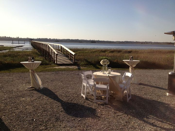 Tables were set up in front of the dock so guests could walk out over the water and enjoy the...