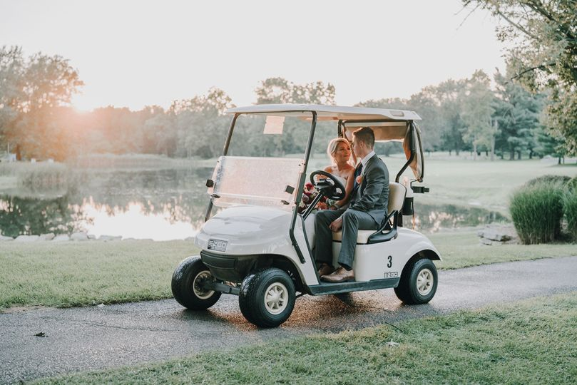 Couple at golf car