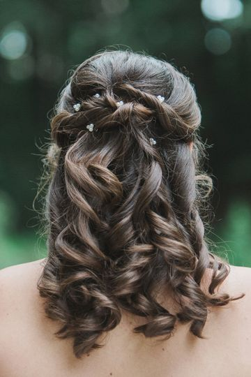 Curled hair pinned back