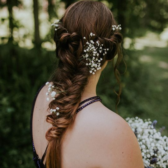 Baby's breath decorating her braids