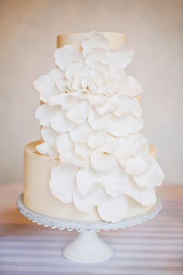 White wedding cake with white decorations