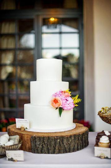 White wedding cake with minimal flower decoration