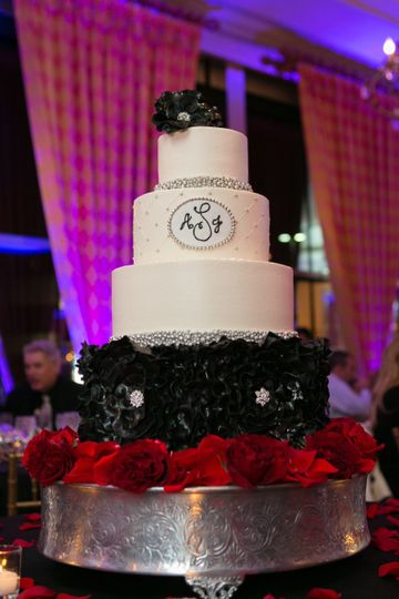 Wedding cake with black and red decorations