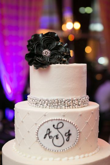 Wedding cake with a black flower decoration