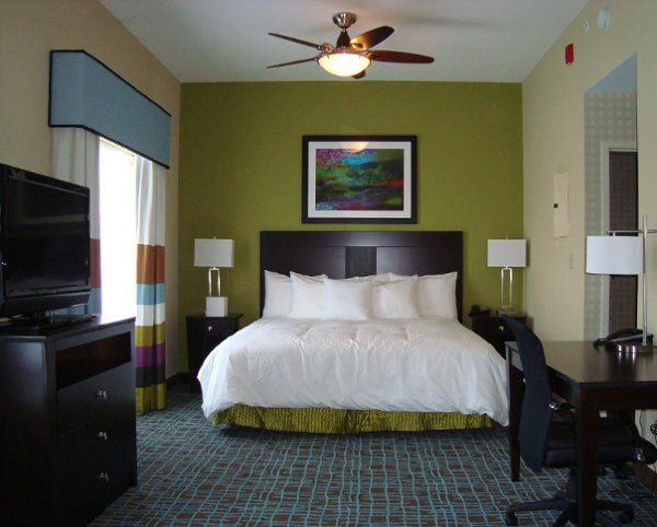 Studio Suite with a King Size Bed and a Couch with a Pull Out Full Size Bed.