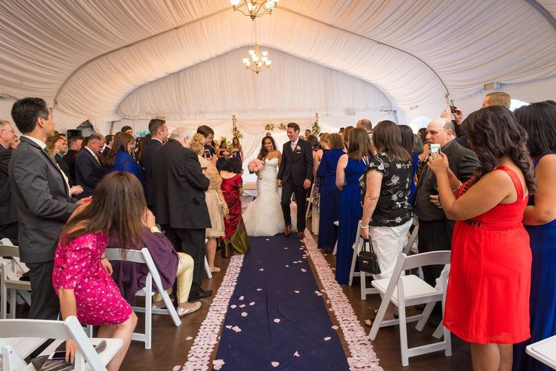 Couple walks down aisle in the Pavilion