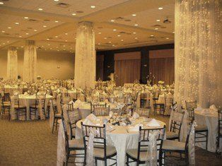 Columns along the center of the room can be draped and lit for a beautiful effect.