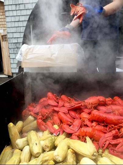 Steamed lobsters and corn