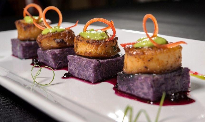 Seared scallops over blueberry risotto