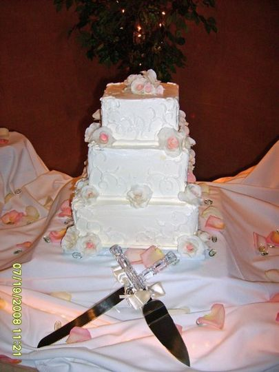This beautiful cake is made with French Buttercream and features handmade gumpaste roses that run...