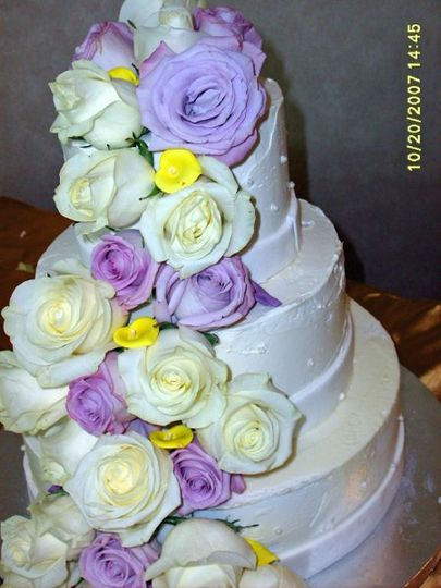 Done in French Buttercream, this summer cake is decorated with fresh-cut lavendar and creamy white...