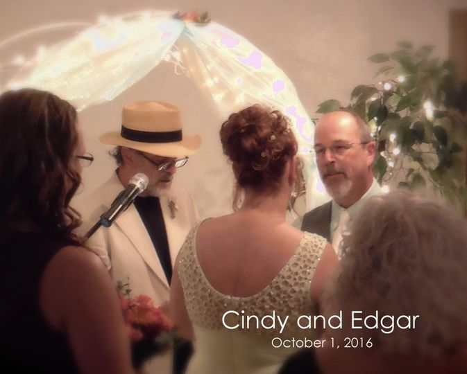 Cindy and Edgar exchange vows.