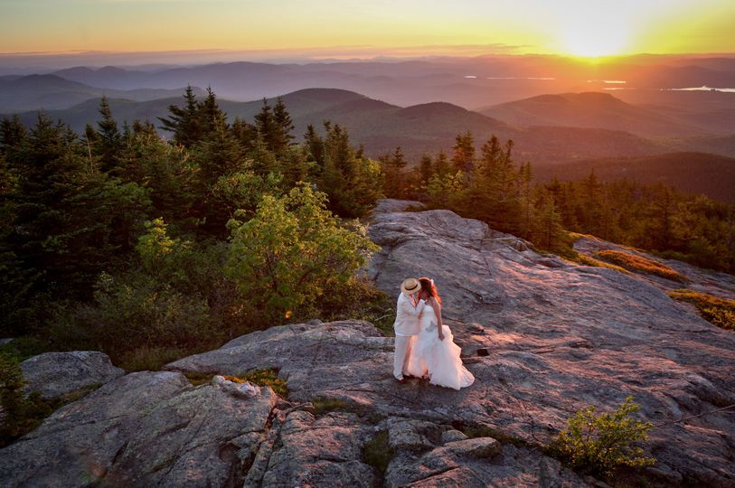 Mike and Barbara kiss atop Mt Kearsarge North where they hiked to the night npbefore stayed in the...