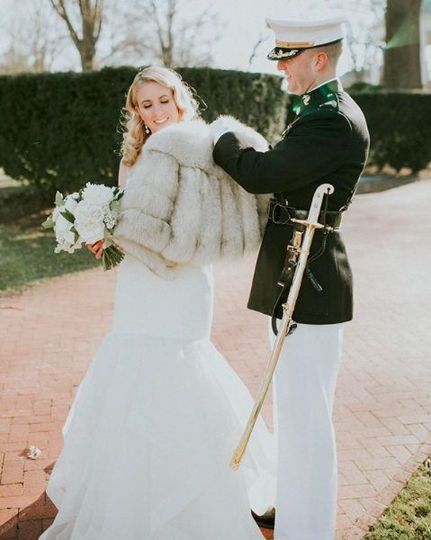 Putting his bride's coat on