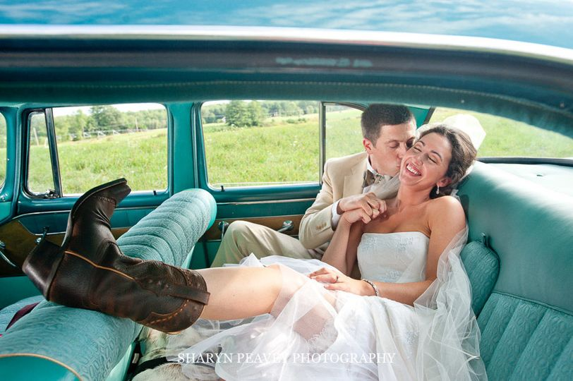 Bride and Groom Portrait in their vintage car