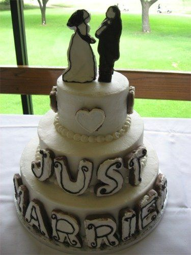 """This fun cake features hand-decorated cookies that spell """"Just Married"""" and cookies for the Bride &..."""