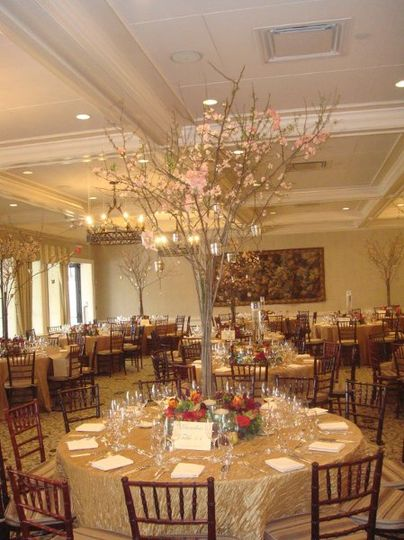 Tall centerpiece with hanging votive candles