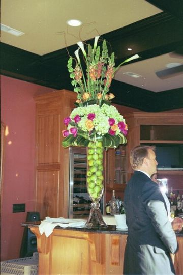 This reception arrangement was transferred from the wedding ceremony to be used at the reception.