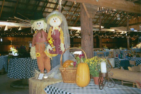 """This whimsical """"bride and groom"""" were used in a rehearsal dinner at the Big Red Barn."""