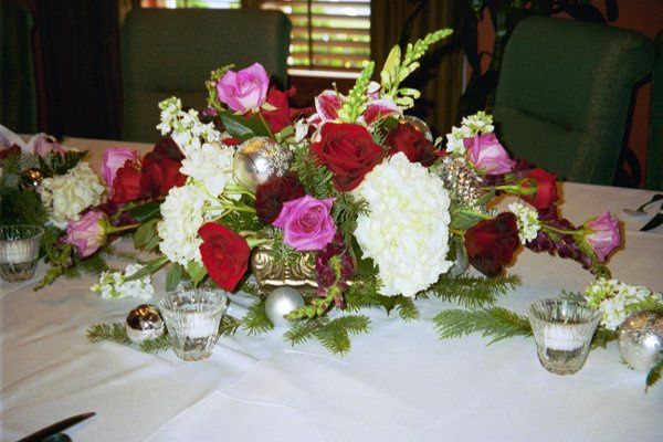 This beautiful Christmas wedding arrangement graced the wedding party table at La Bastide.