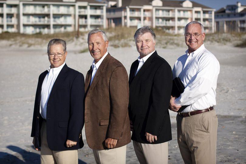 Four men at the beach
