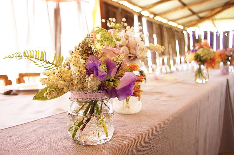 country rustic wedding reception floral centerpiec