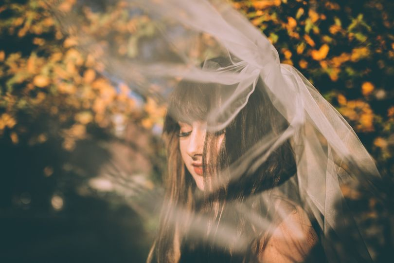 A beautiful, windswept moment from a Detroit bride in Traverse City waiting for the ceremony to...
