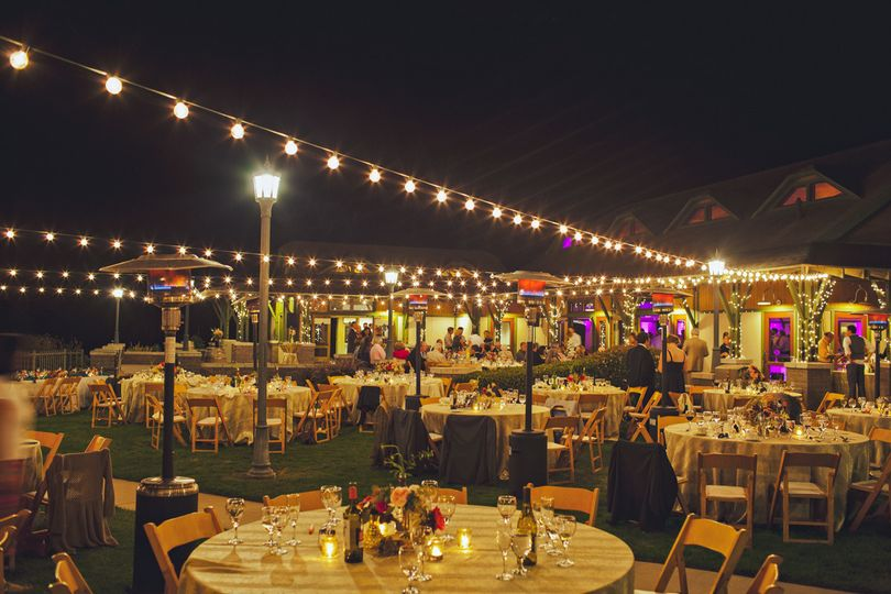 Outdoor reception with hanging lights